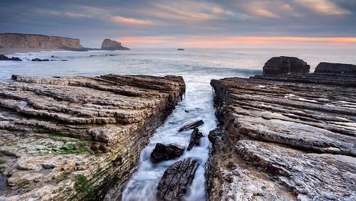 california longexposure sunset santacruz beach water coast moss rocks waves cloudy dusk davenport rockformation pantherbeach wateraction