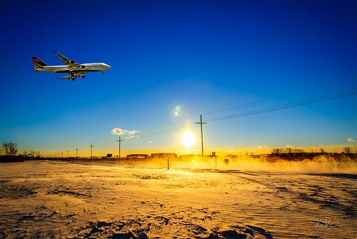 winter sky sun snow field weather sunrise landscape airport nikon michigan aircraft earlymorning 747 jumbojet blowingsnow dtw boeing747400 deltaairlines landscapephotography commercialaviation passengerjet airplanelanding detroitmetroplitanwaynecountyairport