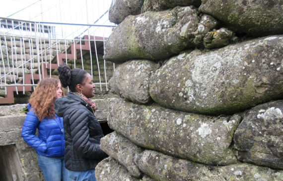 """Fulbrighters at the Dodengang. The pile of cement """"bags"""" to the right is meant to represent the sandbags originally used to bolster the trench walls."""
