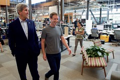 Facebook CEO Mark Zuckerberg gives U.S. Secretary of State John Kerry a tour of Facebook's new headquarters in Menlo Park, California, on June 23, 2016. Earlier, Secretary Kerry delivered remarks at the Opening Plenary of the 2016 Global Entrepreneurship Summit and toured the Innovation Marketplace on the campus of Stanford University. [State Department photo/ Public Domain]