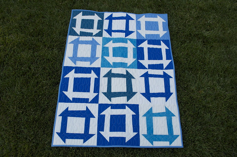 Blue and White Quilt Featuring Modern Angular Pattern