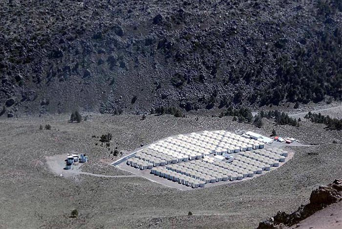 The HAWC Observatory taken in August 2013 from the summit of Sierra Negra.  The image has been digitally altered to show HAWC as it will appear when construction is complete in 2014.  The 111 Cherenkov detectors currently installed (100 Cherenkov detectors in operation) are colored white and located in the upper right quadrant of the array.