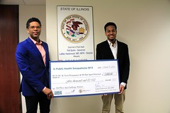 Illinois Department of Public Health Director Dr. LaMar Hasbrouck Presents Award to Joshua Chestang of the IL Teen Pregnancy & SDI Hot Spot Detector