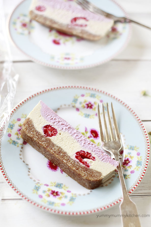 Beautiful slices of raw vegan raspberry cheesecake on a plate. This is such a pretty Valentine's Day dessert!