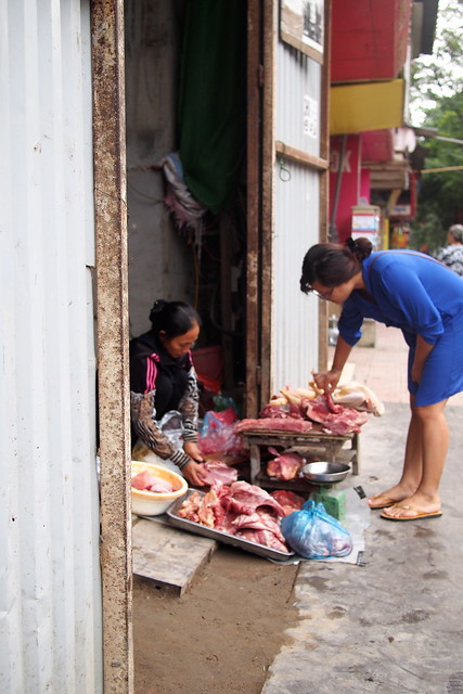 street-side meat seller, Hanoi, Vietnam
