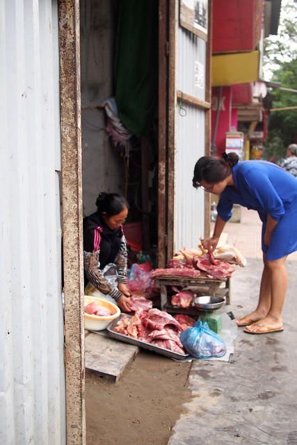 street-side meat seller, Hanoi, Vietnam