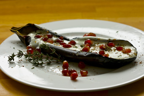 Aubergine with buttermilk sauce & pomegranate seeds