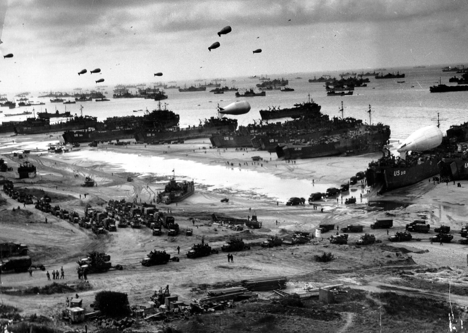 Landing ships putting cargo ashore on one of the invasion beaches, at low tide during the first days of the operation, June 1944
