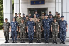 Vice Adm. Joseph P. Aucoin, the commander of U.S. 7th Fleet, and Vice Adm. Lee, Ki-sik, the commander of the Republic of Korea Fleet, pose for a photo with their respective warfare commanders after an Anti-Submarine Warfare (ASW) Cooperation Committee discussion.  (U.S. Navy/MC3 Jermaine M. Ralliford)