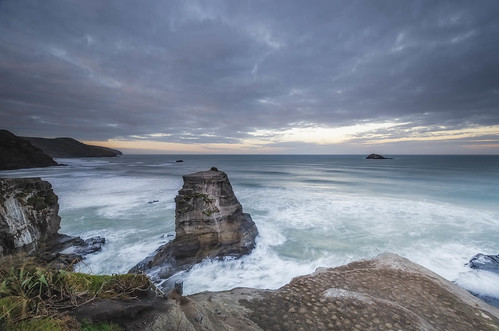 longexposure newzealand clouds sunrise nikon rocks surf waves wideangle cliffs auckland nz northisland westcoast muriwai earlymorninglight leefilters 1024mm oaiaisland d7000 lee09nd motutaraisland lee06gndhard