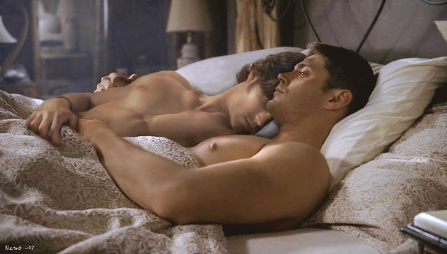 Sam and Dean lie naked in bed together
