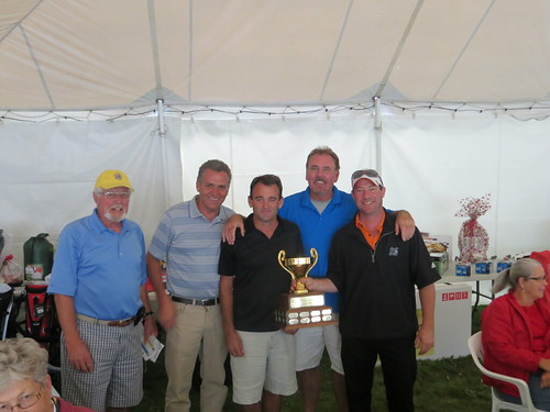 Lion President Larry Simpson presents the trophy to the winning foursome at the Lions Golf Tournament. L-R Lion Larry, Curly McMann,Jim Fletcher, John Graham and Dean Laurie