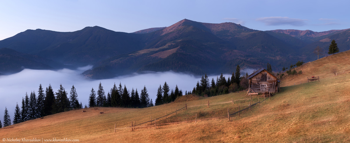 Panorama of autumn mountain hills at sunrise
