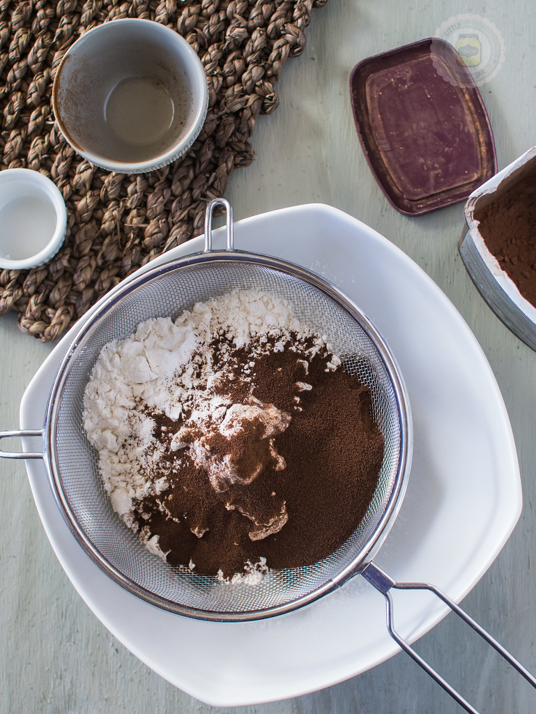 Measuring and sifting dry Ingredients together, including the cocoa powder and the espresso powder