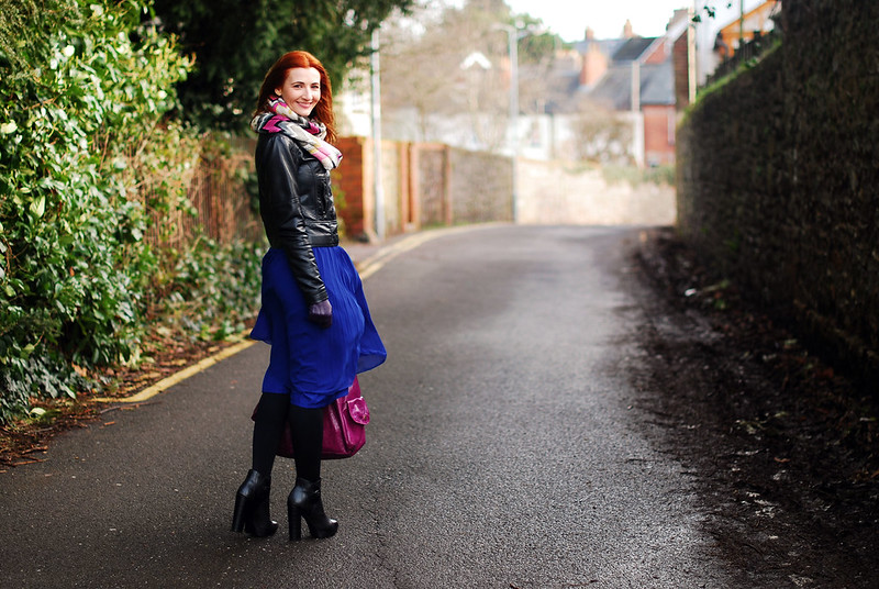 Black leather jacket & blue pleated skirt