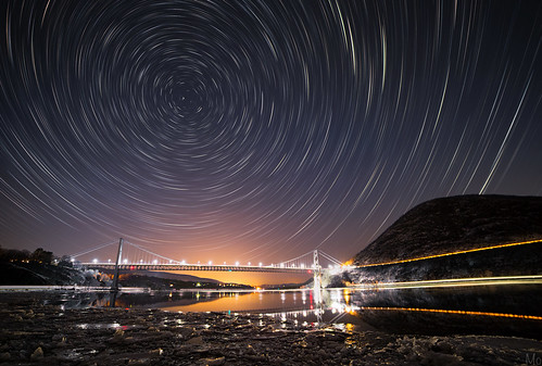 longexposure travel bridge winter sky newyork motion cold ice water metal night river print stars landscape outdoors photography photo scenery gallery unitedstates image fineart scenic picture canvas bearmountain astrophotography rotation hudsonriver garrison startrails polaris northstar bearmountainbridge mikeorso