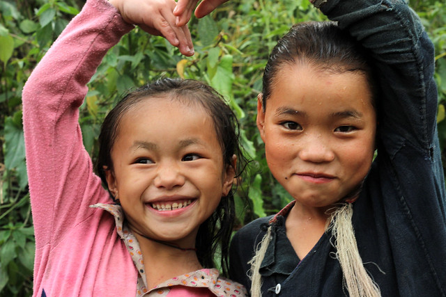 Two hilltribe children pose in Luang Namtha, Laos