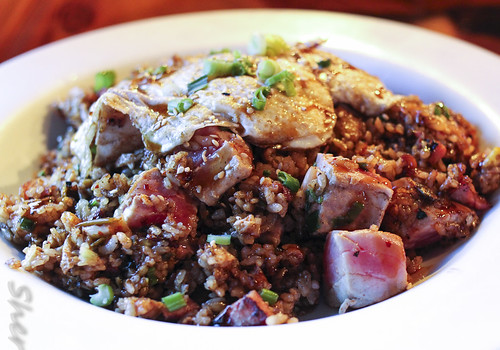 Seared Ahi poke w/ teriyaki kim chee fried rice covered with 2 eggs over easy