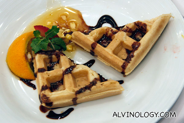 Waffle with orange sauce
