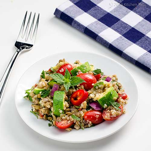 Lentil, Quinoa, and Zucchini Salad on plate with mint garnish