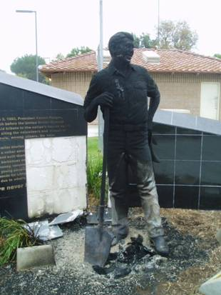 REAGAN STATUE Vandalized by arsonists; Sept. 21, 2013