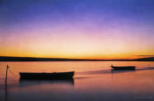 longexposure sunset sea motion blur beach water night boats evening movement cove lagoon dorset fleet weymouth chesil smugglers slowshutterspeed smuggling moored falkner trenchard moonfleet chickerell canon5dmarkii richardbeech mohune