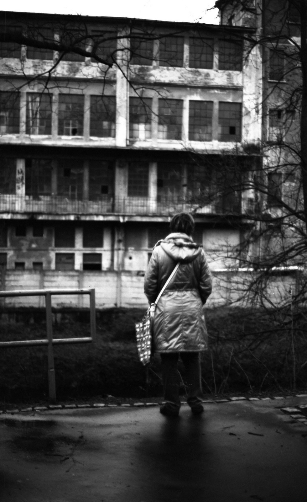 Canon Rebel XS + ORWO DP3 film - Woman Looking at Abandoned Factory