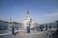 Sailors aboard USS John S. McCain (DDG 56) prepare to stow mooring lines as the ship gets underway, Feb. 1. (U.S. Navy photo by MC3 Ricardo R Guzman)