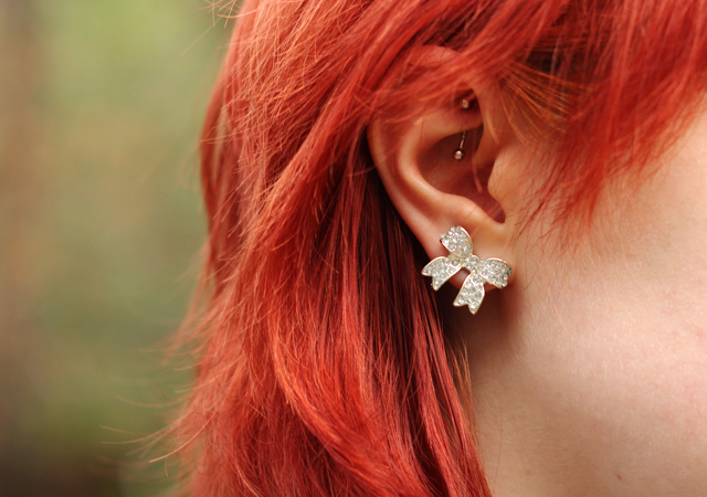 Silver Bow Earrings and a Rook Piercing with Red Hair