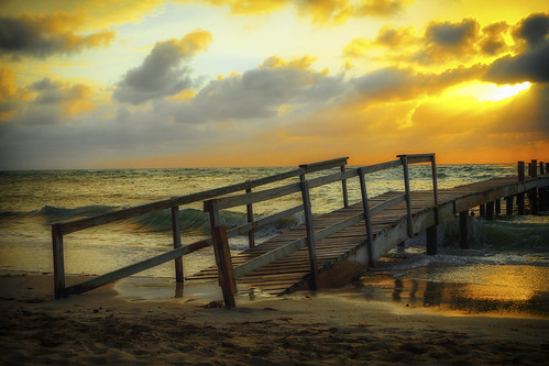 ocean wood sunset sky orange sun reflection beach water clouds wooden dock sand waves fuji dusk honduras roatan explored colourtone fujixpro1