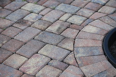 floor(0.0), asphalt(0.0), stone wall(0.0), soil(0.0), roof(0.0), tile(0.0), flooring(0.0), sidewalk(1.0), flagstone(1.0), cobblestone(1.0), road surface(1.0), brick(1.0), brickwork(1.0),