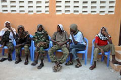 Former Al-Shabaab combatants who handed themselves over to the Somali government. Defections by Al-Shabaab members were rising dramatically, with many more expected in the coming months. Credit: Abdurrahman Warsameh/IPS