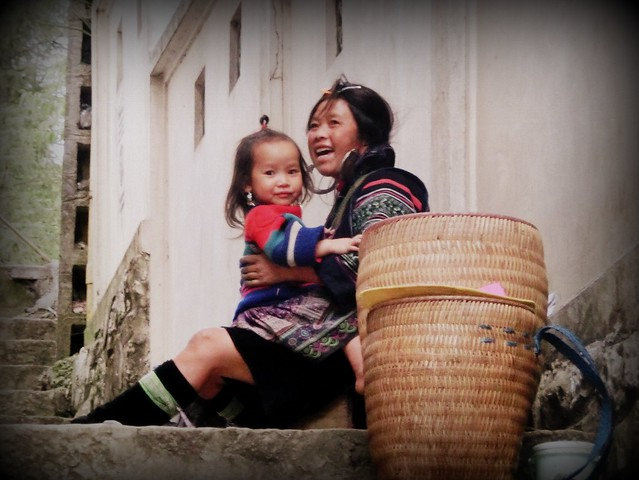 A local Hmong woman plays with her daughter in Sapa