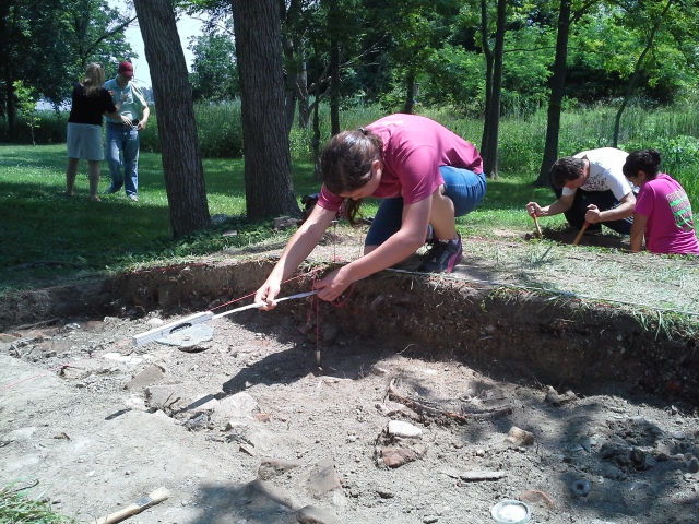 Student Katie Hutchinson measuring the location of various artifacts