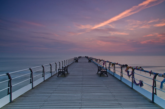 On the pier at dawn.