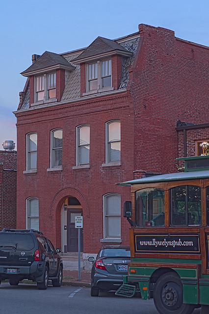 Soulard Neighborhood, in Saint Louis, Missouri, USA - Mansard home with bus