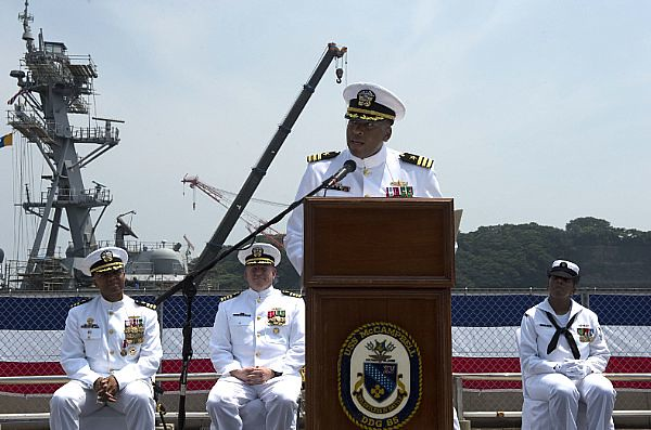 Cmdr. Sharif H. Calfee addresses his crew and guests after assuming command of USS McCampbell