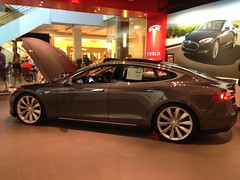 audi a7(0.0), automobile(1.0), tesla(1.0), executive car(1.0), aston martin rapide(1.0), wheel(1.0), vehicle(1.0), performance car(1.0), automotive design(1.0), auto show(1.0), full-size car(1.0), audi sportback concept(1.0), sedan(1.0), land vehicle(1.0), luxury vehicle(1.0),