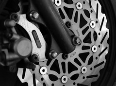 rim(0.0), steering wheel(0.0), alloy wheel(0.0), engine(0.0), groupset(0.0), tire(1.0), automotive tire(1.0), wheel(1.0), vehicle(1.0), monochrome photography(1.0), monochrome(1.0), crankset(1.0), black-and-white(1.0), black(1.0), spoke(1.0),