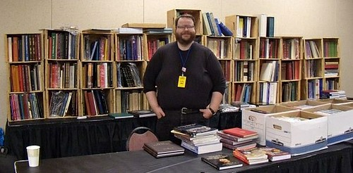John Burns at PAN show table