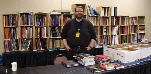 John Burns at PAN show table