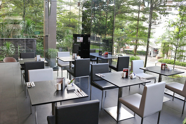 The dining area is really peaceful and relaxing, surrounded by greenery and water features