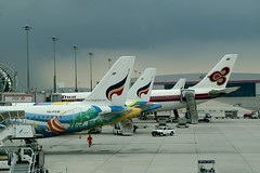 Tails of Bangkok Airways and Thai Airways International at Suvarnabhumi Airport, Bangkok, Thailand