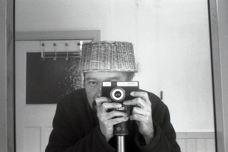 reflected self-portrait with Smena Symbol camera and basket hat