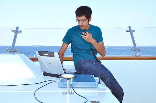 Graduate student Jahshan Bhatti with the laptop equipment used to spoof the superyacht's GPS.