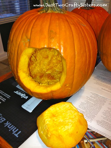 Cut the back out of the pumpkin instead of the top