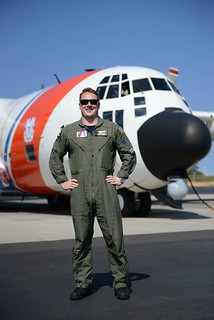Lt. j.g. Matthew Chase is shown in front of an HC-130 Hercules airplane at Coast Guard Air Station Barbers Point in O'ahu, Hawaii July 31, 2013. Chase graduated from the Coast Guard Academy in 2011 and subsequently fulfilled his lifelong dream of becoming a Hercules pilot. (U.S. Coast Guard photo by Petty Officer 3rd Class Tara Molle)