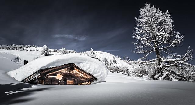Switzerland: Snowy swiss Mountain Cabin