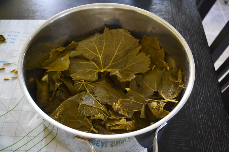 Top stuffed grape leaves with leftover grape leaves to help steam.