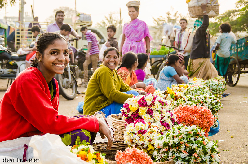 smiling girls selling flowers gudimalkapur